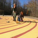 Liz and Janette freshen the paint on the labyrinth.