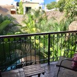 This is a view from the balcony of one of the rooms looking down at the pool and toward the offi