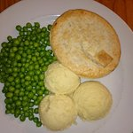 Meat and mushroom pie with mash and peas