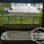 Inside bath and toilet have views of the waterhole as well as the outside shower