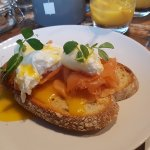 Poached eggs on toasted sourdough with salmon