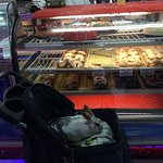 My pet rabbit, Narvik; explores the bakery from the comfort of his stroller.....