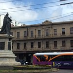 Photo of hotel with statue on Queen Victoria in front of it