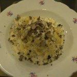 Flambé cheese pasta with truffle shavings