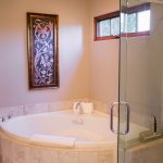 Whirlpool Tub for Two and Glass-enclosed Shower in Our Cortona Guest Room