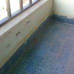 Balcony tiles stuck with glue!!