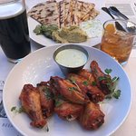 "Glazed wings and flatbread. Oh, an the ""Oatmeal Stout"" and ""Instant Gratiification"" to drink."
