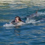 My wife being pushed by two dolphins!