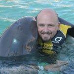 Giving the dolphin a hug .... awwwwwww