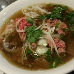 Large pho dac biet and green onion cake for $19.50 @pho hon pasteur