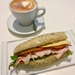 Latte and turkey sandwich on fresh bun