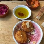 The goat cheese croquetas and Cat's handmade bread with beet dip and another tasty dip.