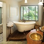 Loose yourself in the vintage beach villa's bathroom with claw foot bathtub