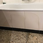 poorly maintained bathroom, stained tiles