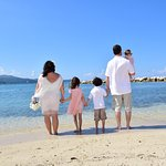 10 year vow renewal on beach with children