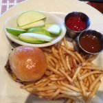 kids cheeseburger with French fries & catsup, and apple slices with caramel sauce