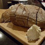 Freshly baked bread with whipped honey butter