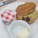 Doughy (reheated, not fresh) scone with a stingy portion of cream