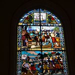 The leadlight windows tell the story of the original church, now museum.