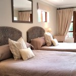 Room 1 is a double room with 2 normal double beds
