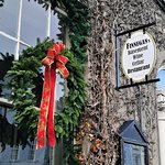 The entrance of Finnegan's Restaurant & Wine Cellar with Christmas decoration