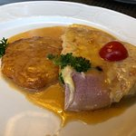 Pork cutlet with ham and cheese. Rosti (potato pancake) and an amazing sauce.