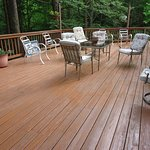 Large deck overlooking hemlock-lined ravine with view of waterfall.