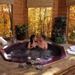 "Hot tub inside of our ""Cupid's Hideout"" cabins."