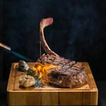 Tomahawk 42oz. for 2, sliced at your table.