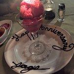 Raspberry Sorbet w/ frozen chocolate scrolling on plate