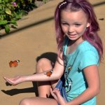 My beautiful granddaughter waiting for a butterfly to land on her.