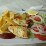 Grilled squids with chips and salad