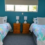 Two single beds in two bedroom cottage