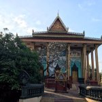 Buddhist pagoda - in stark contrast to the impoverished village homes nearby with it extravaganc