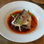 Grilled sea bass fillet in escabeche