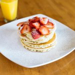 fresh juicy sweet strawberries on our fluffy buttermilk pancakes