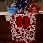 Home made poppies sold in aid of the British Legion cover this tree
