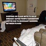 Sleeping on floor with tv on to overcome 24-7 banging noise between floors