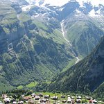 Gimmelwald hamlet from a trail above the town, with the gorgeous alpine mountains across the val