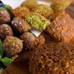 Falafel is a deep-fried ball or patty made from ground chickpeas, fava beans, or both