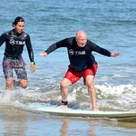 Taking surfing lessons from TSE in Tamarindo from Jony (Johnny). Great instructor I am 71 years