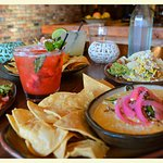 Queso with Roasted Carnitas, Pickled Onlons, and Fresh Peppers