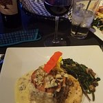 Blue cheese encrusted filet, roasted tomato, green chili potatoes with spinach & mushrooms