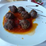 Veel (and pork and beef) meatballs in tomato sauce