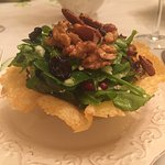 Mixed greens salad with blue cheese, dried blueberries, walnuts served in parmesan crisp bowl