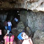 Entry point to the cave showing narrow bu well-lit opening