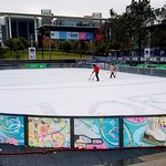 Shoveling snow off the ice rink in December. Yes, snow!
