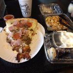 Slice of the gladiator pizza, side of pasta salad and a chocolate covered cannoli, YUM.