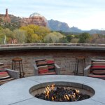 Fire pit at Tii Gavo with red rock formations beyond