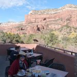 Outdoor patio at Tii Gavo with red rock cliffs beyond